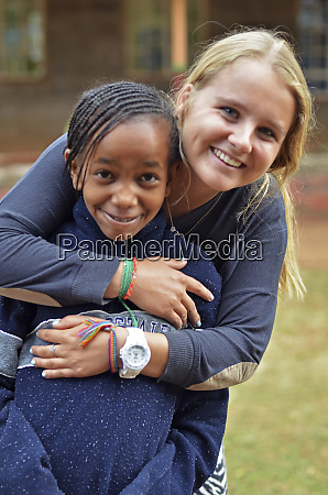 kenya nairobi european volunteer hugging local