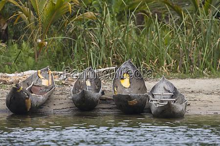 africa madagascar lake ampitabe dugout canoes