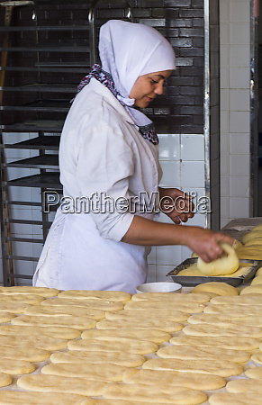 tangier morocco local woman baking bread