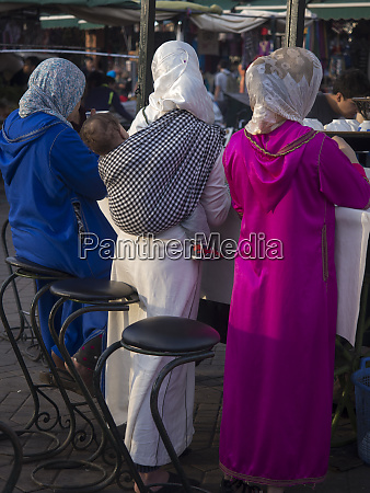 women at stall in marrakech morocco