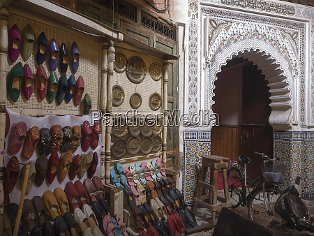 footwear shop and arched entrance in