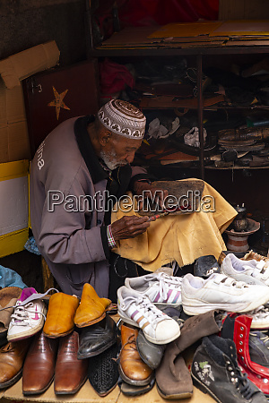 marrakech morocco man sewing