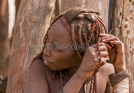 africa namibia opuwo himba woman tends