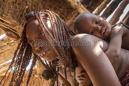 africa namibia opuwo himba mother carrying