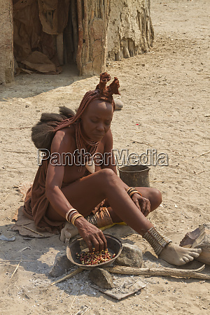 africa namibia himba woman making breakfast