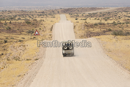 namibia safari vehicle travels down an