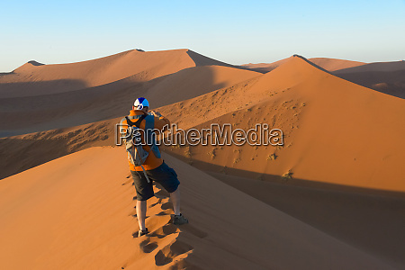 tourists photographing sand dune 45 in