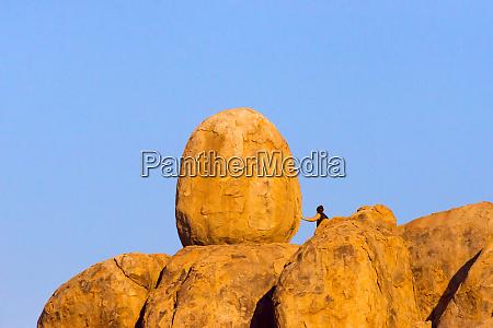 tourist on granite hill damaraland kuene