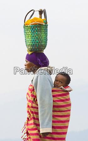 woman carrying basket on head rwanda