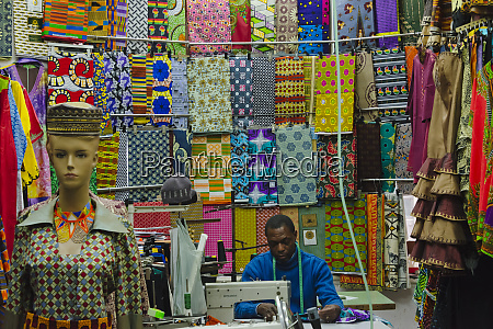 tailor at a fabric shop cape