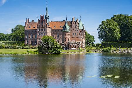 pond before the castle egeskov denmark