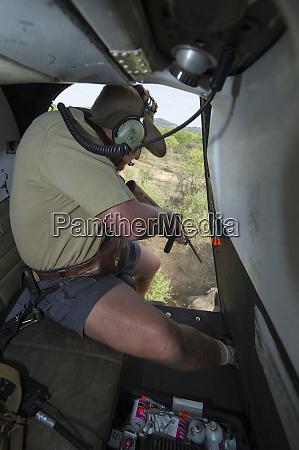 elephant capture vet preparing to dart