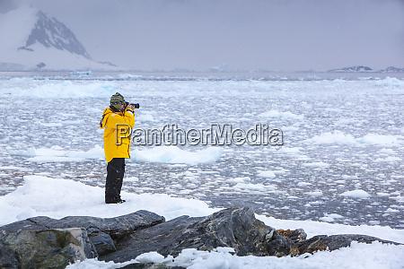 antarctica photographer taking photos of the