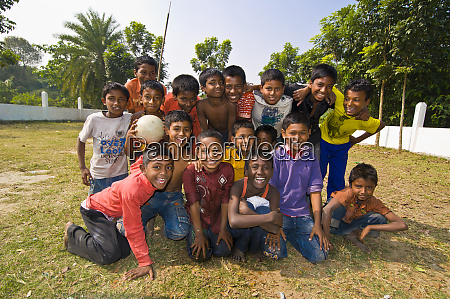 friendly young guys after playing football