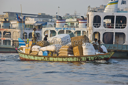 loaded barge in the busy harbor