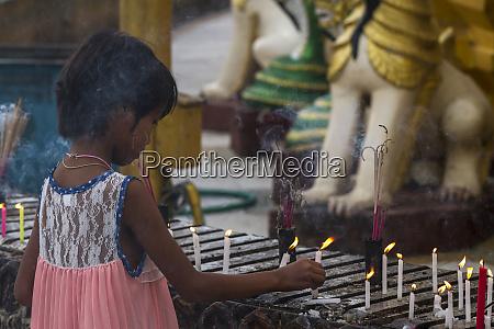 myanmar yangon a young girl places