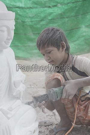 myanmar mandalay a young boy using
