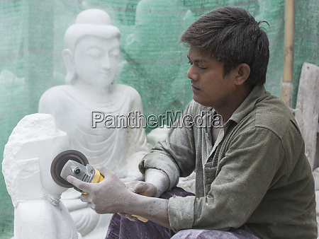 myanmar mandalay a young man using