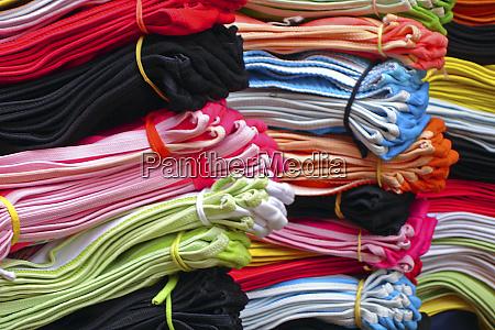 selling cloths in soucoupira market praia