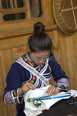 chinese ethnic women at kunming china