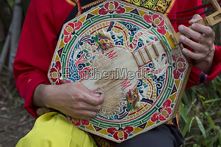 playing colorful chinese stringed instrument at