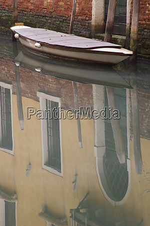 italy venice building and boat reflections