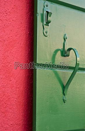 italy burano handle on green shutter