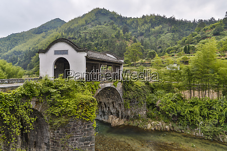 ancient chinese bridge over river in
