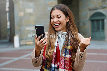 happy excited young woman laughs watching