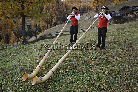 father and son alp horn players