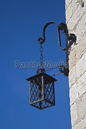lamp hanging at corner of building