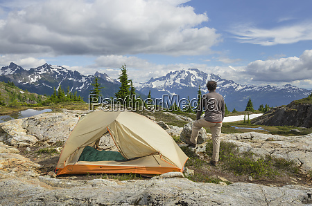 adult man admiring view from backcountry