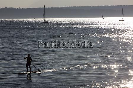 elliott bay seattle washington state paddleboarder
