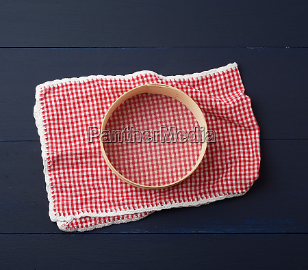 textile red napkin and a round