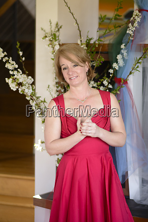 bride in red dress at her