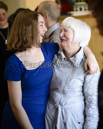 older woman and teen girl