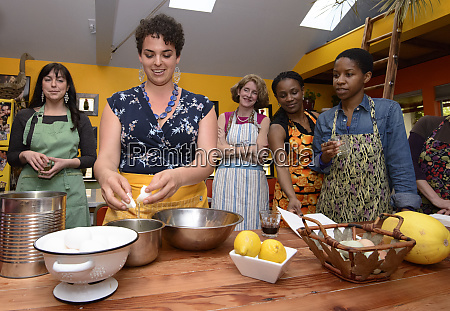 five women at a cooking class