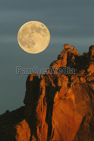 full moon at sunrise above the