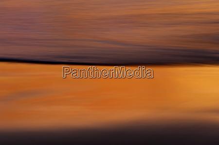 california long exposure wave at sunset