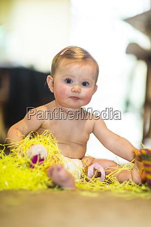baby girl enjoying easter basket and