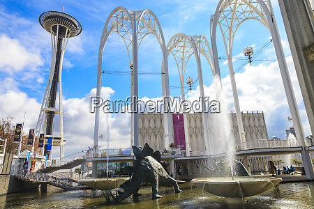 dinosaur sculpture and fountains at the