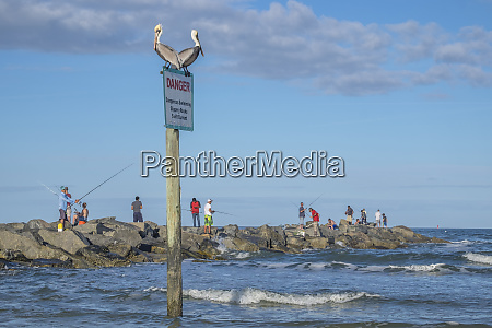 people fishing from jetty new smyrna