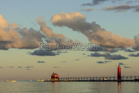 sunrise clouds over lake michigan fishermen