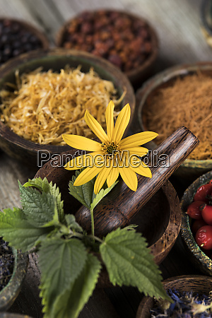 natural remedy herbal medicine and wooden