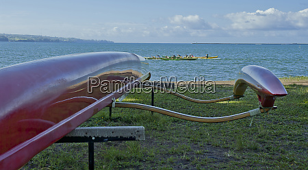 colorful and sleek outrigger canoe waiting
