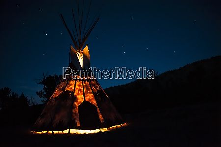 teepee lit from inside against the