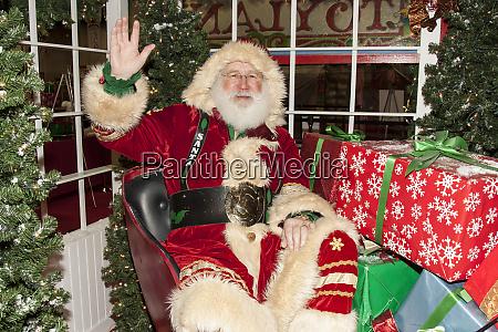 santa claus sitting in his sleigh