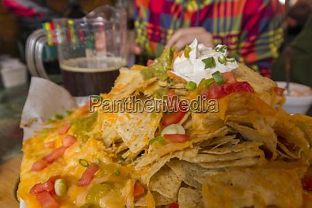eating nachos at hellroaring saloon at