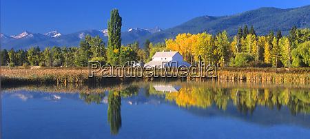 a white barn and beautiful fall