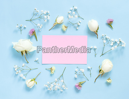 flowers and pink paper on a